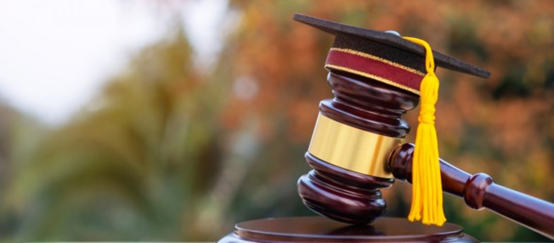 graduation-diploma-hat-judge-gavel-school-lawyer-concept-graduate-study-international-abroad_4236-1882